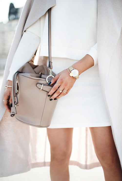 Lisa Olsson is wearing a cream coat from Filippa K., bag from Zara and white top and skirt set from Forever 21