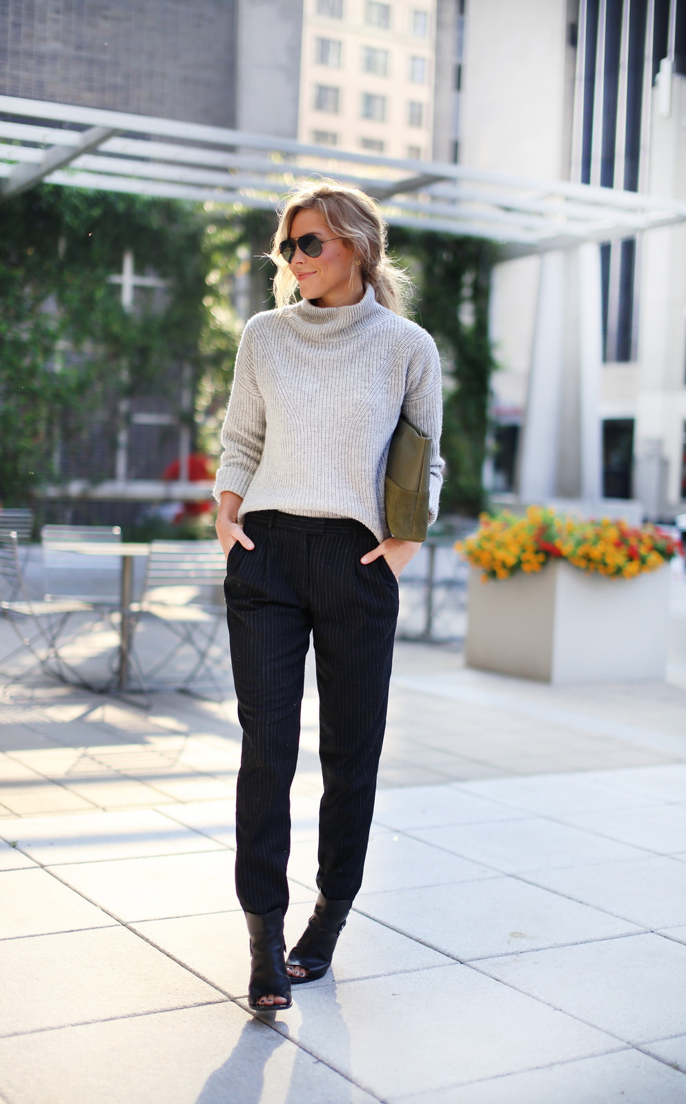 Mary Seng is wearing grey jumper from French Connection, trousers from Michael Kors, shoes from Rag & Bone, clutch from Elaine Turner and the sunglasses are from RayBan