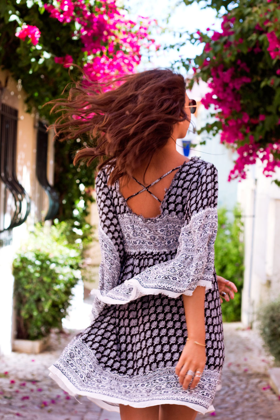 Kayla Seah is wearing a black and white dress from Free People