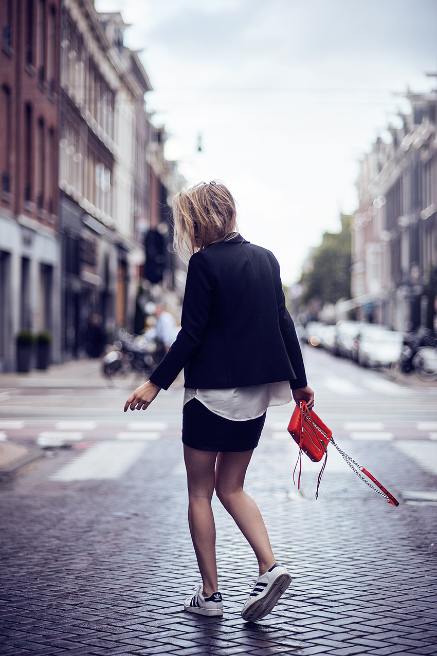 Rebecca Laurey is wearing a shirt from Filippa K, leather skirt and blazer from Ganni, shoes from Adidas and the bag is from Rebecca Minkoff