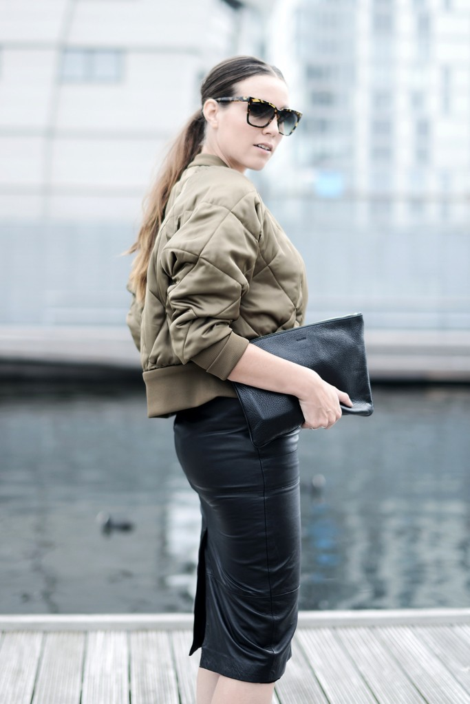 Cindy Van Der Heyden is wearing a bomber jacket from Zara, leather pencil skirt from Asos, clutch from Jill Sander and sunglasses from Dita
