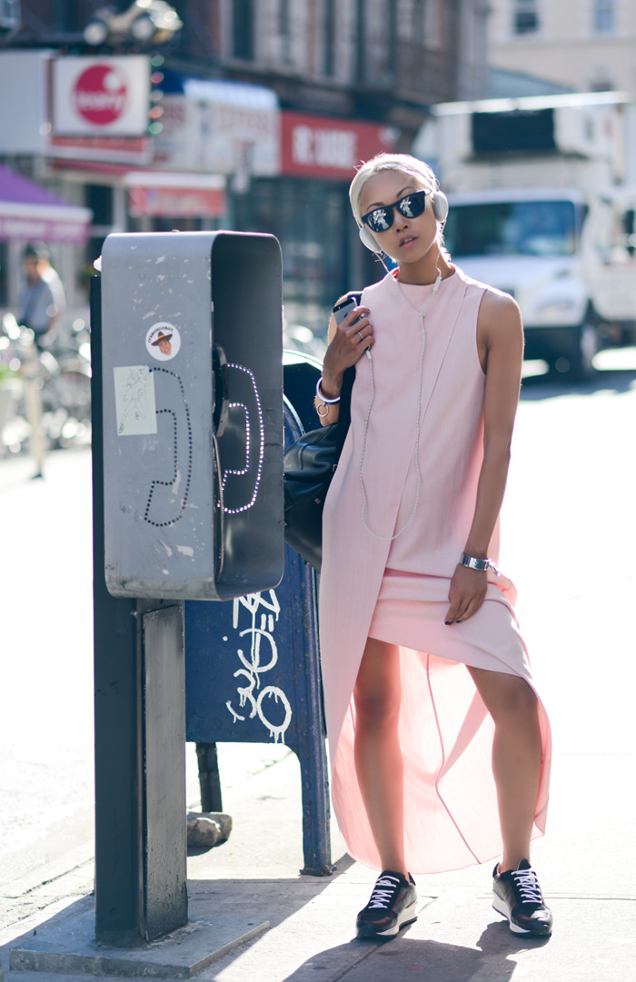 Vanessa Hong is wearing a pink dress from Kaelen and sneakers from Opening Ceremony
