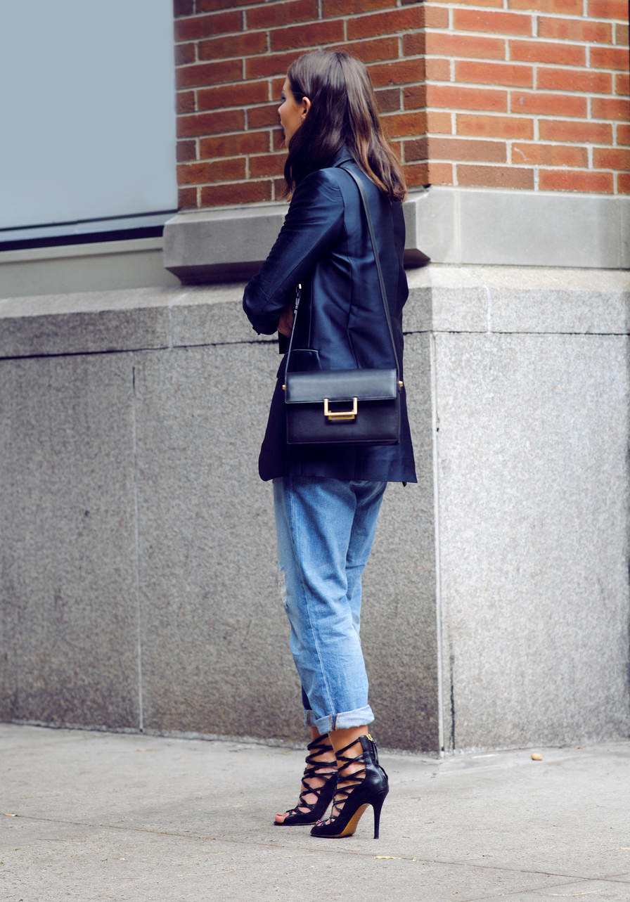 Sara Donaldson is wearing a navy blazer from Zimmermann, jeans from J Brand, shoes from Isabel Marant and the bag is from Saint Laurent bag