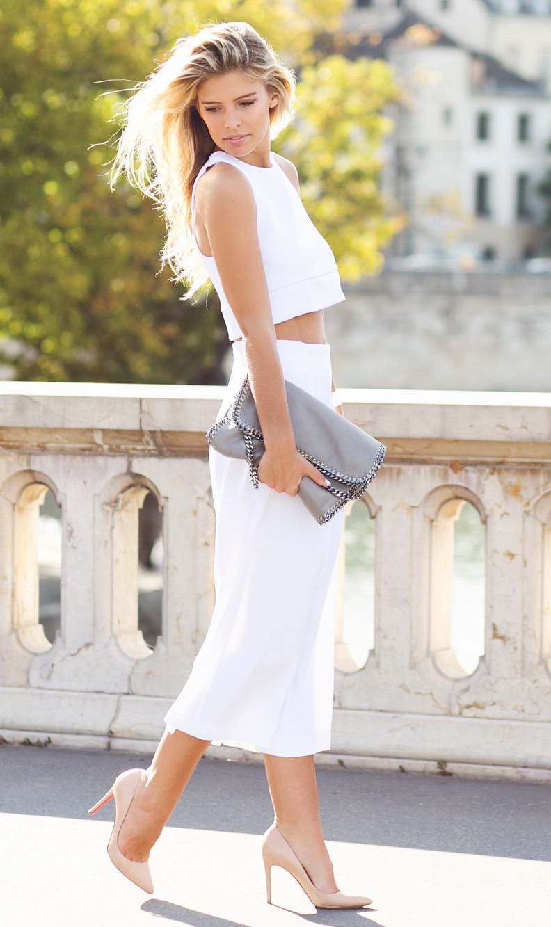 Natasha Oakley is wearing a white top and skirt from Backstage Clothing, shoes from Christian Louboutin and a bag from Stella McCartney
