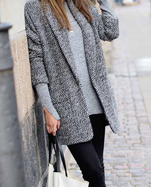 Funda is wearing a grey and black, cardigan from MBYM, sweater and jeans from Zara and a bag from Celine