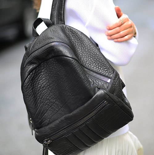 Zina Charkoplia is wearing a leather backpack from All Saints