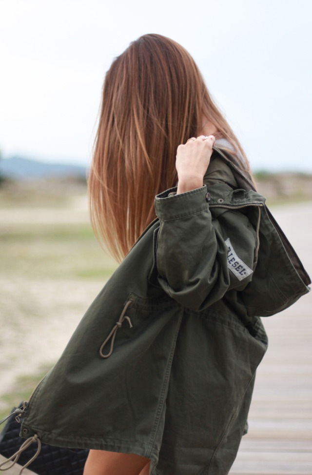 Silvia Garcia is wearing a military jacket from Diesel