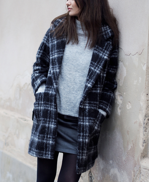 Funda Christophersen is wearing a plaid coat in wool and mohair blend from Ganni