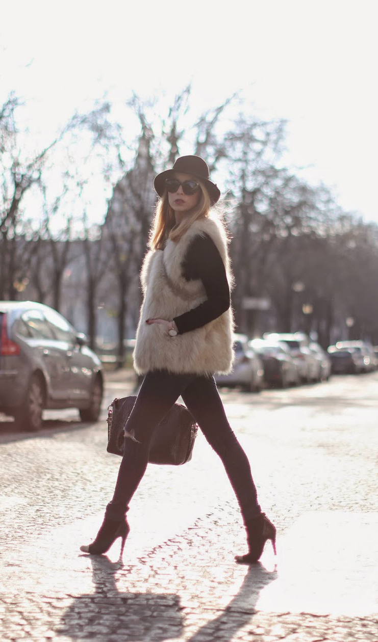 Furry Vest Trend: Caroline Louis is wearing a furry faux fur vest from Maje