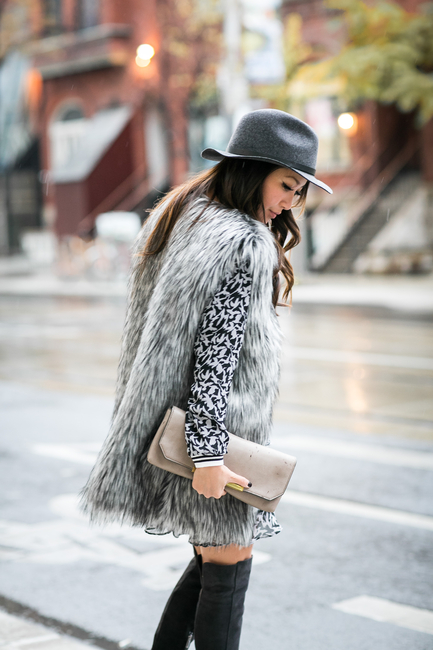 Wendy Nguyen is wearing a grey faux fur vest from Joe West