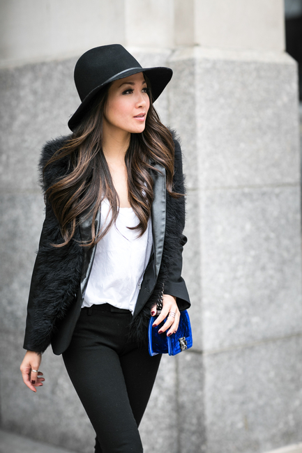 Wendy Nguyen in her black furry vest from Club Monaco