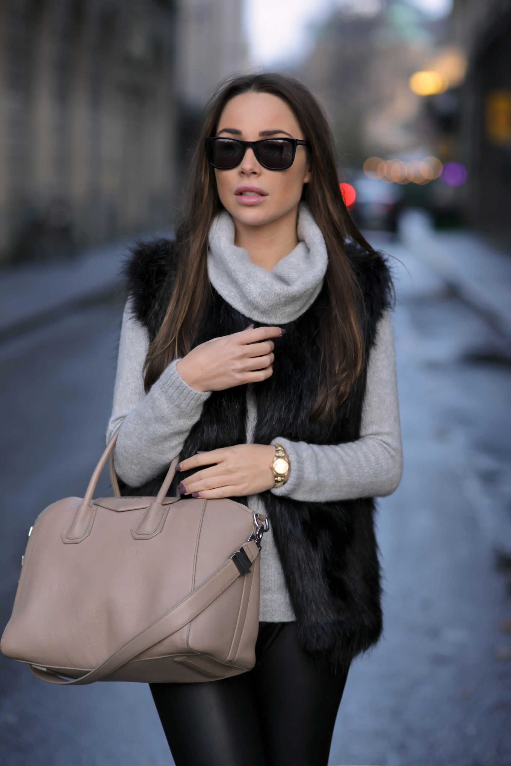 Johanna Olsson is wearing a black faux fur vest from Pieces