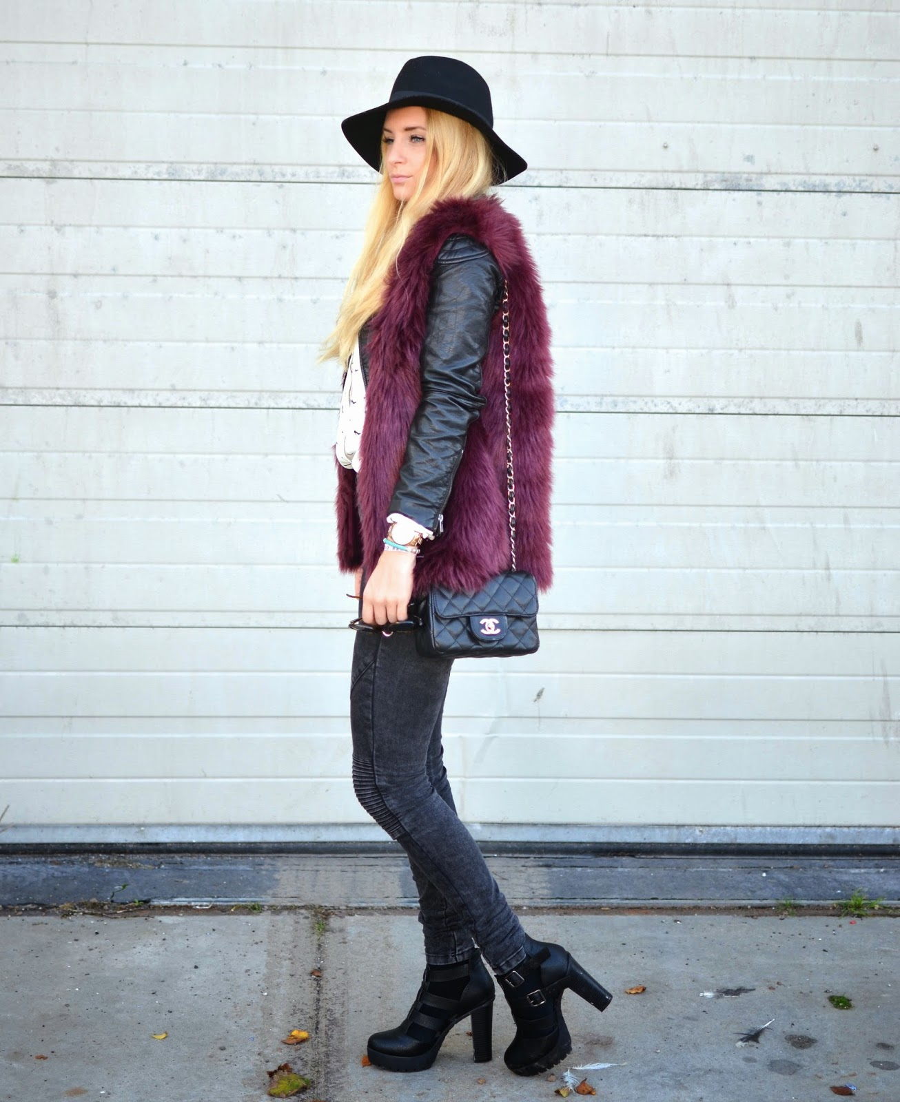 Charlotte Schouten is wearing a burgundy faux fur vest from Seven Sisters