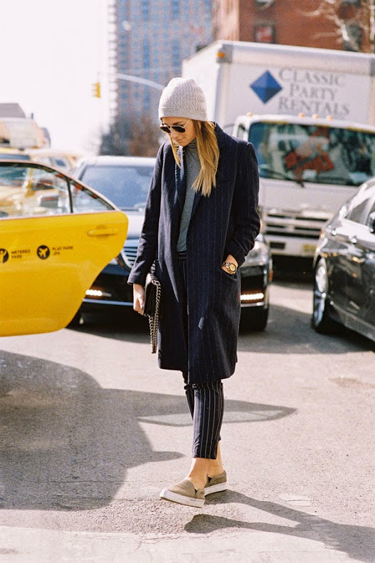 Danielle Bernstein from We Wore What is wearing a pinstripe outfit mix, (coat and trousers). Photographed by the amazing Vanessa Jackman at New York Fashion Week
