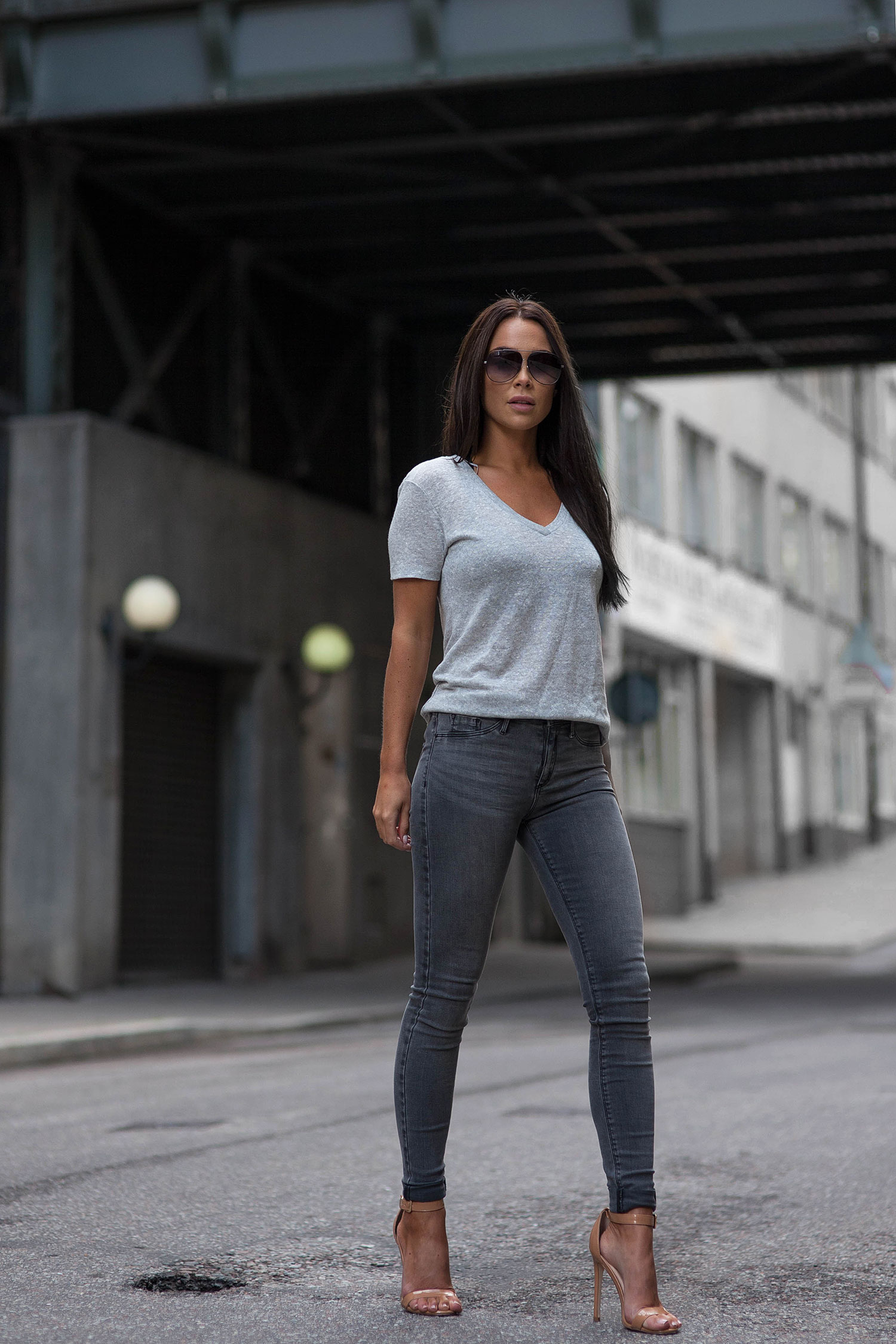 74c816390c Johanna Olsson is wearing a grey v-neck over a darker paired of grey  skinnies.