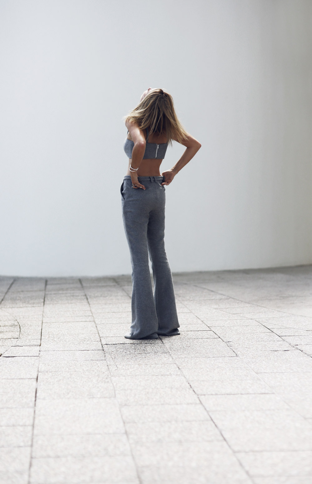 Mandy Shadforth is wearing a grey bralett and trousers from Anna Quan