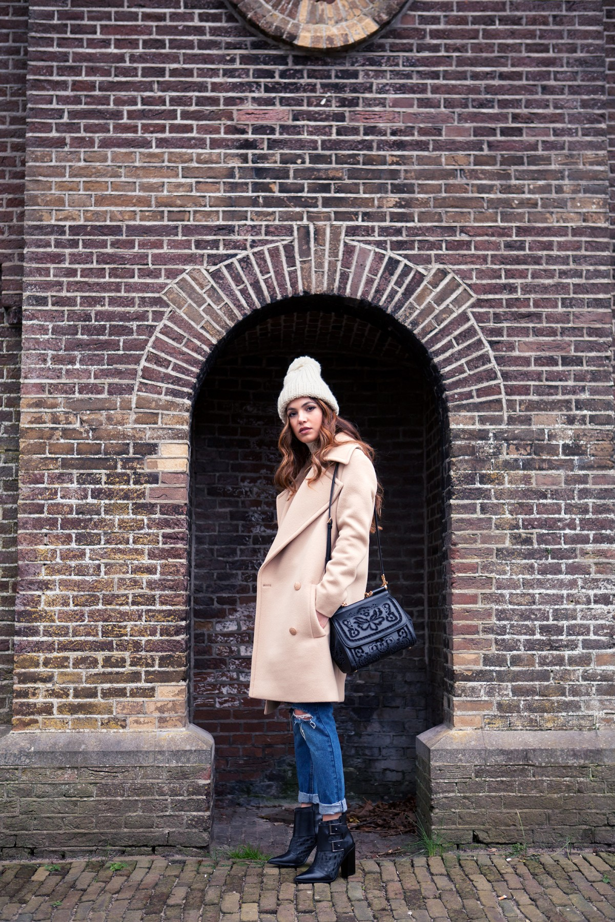 Negin Mirsalehi is wearing a camel colored coat from Stella McCartney