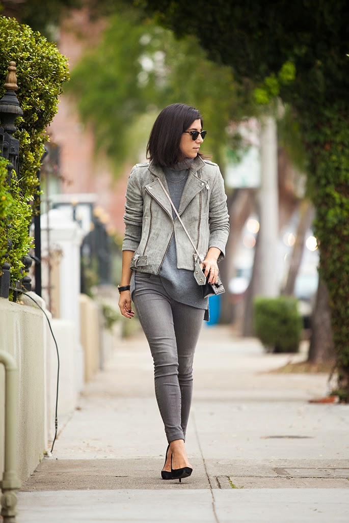 Krystal Bick is wearing all grey, leather acket fromIRO, sweater from Everlane, jeans from J.Brand and the shoes and bag are both from Saint Laurent