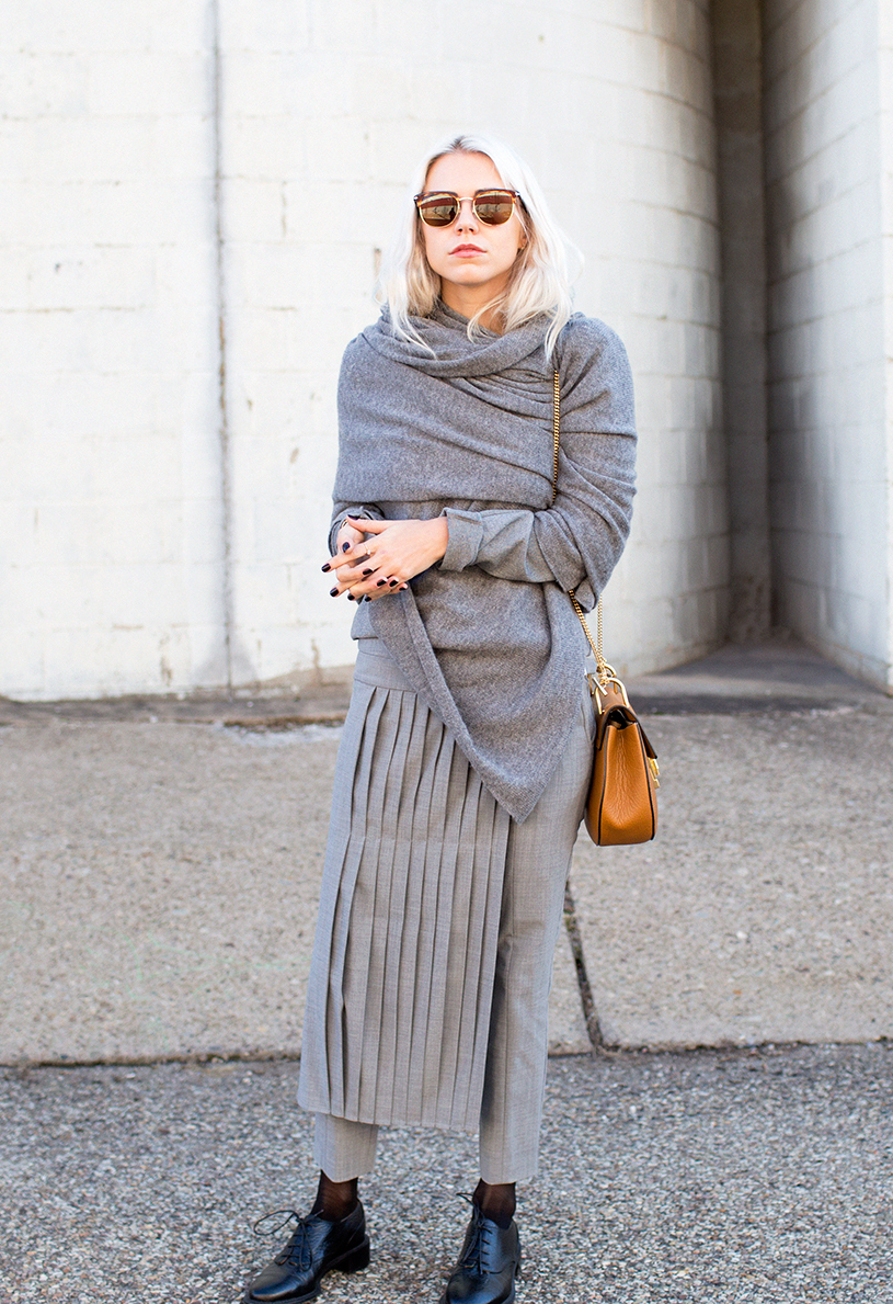Grey Outfits And Idea: Courtney Trop is wearing all grey, top from 10 Corso, trousers and skirt from Tibi, bag from Chloe, scarf from Equipment and shoes from Rocha