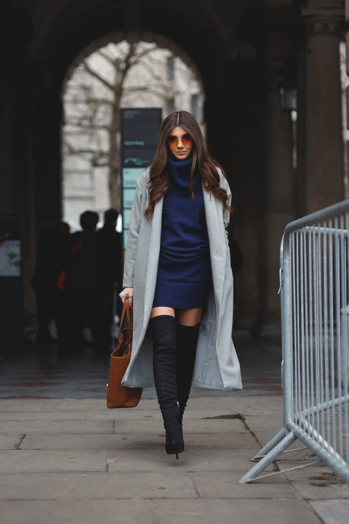 c034a78599 Sweater dress and boots  Larisa Costea is wearing a navy sweater dress from  Sheinside