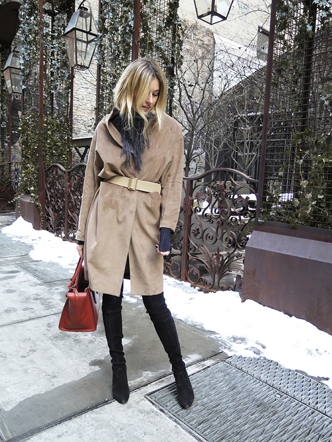 Camille Charriere is wearing a Flippa K suede coat