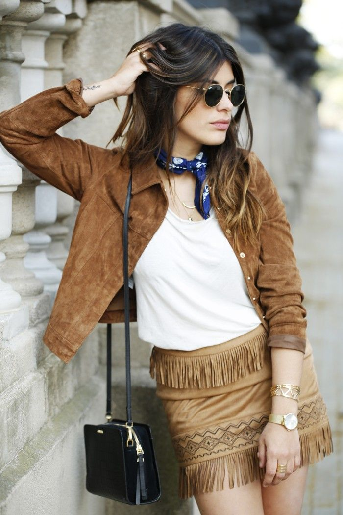 Aida Domenech is wearing a brown suede jacket from Mango, white T-shirt from H&M, fringed skirt is from Buylevard and the bag is from Calvin Klein