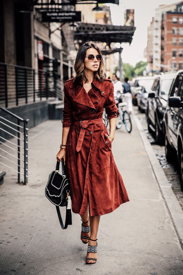 This stylish red suede coat looks effortlessly chic with patterned sandals and a simple black bag. Via Annabelle Fleur. Coat: Rebecca Minkoff.