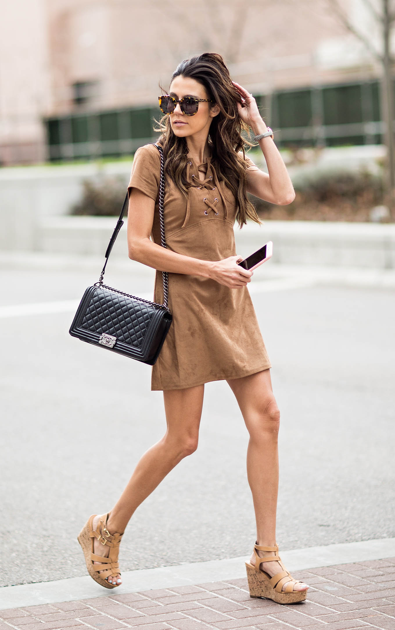 There is no cuter look on the scene than the suede trend! Christine Andrew creates a simple but stylish look by combining a suede lace detail dress with wedges and a quilted black bag. Wear this look with sunglasses to get that ultimate summer feel! Dress/Shoes: Express.
