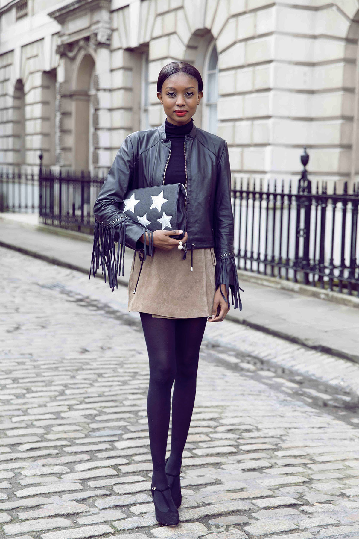 Suede Fashion Trend: Natasha Ndlovu is wearing a wrap skirt in suede with ties from Asos
