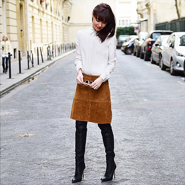 @lornaluxe is wearing a suede mid length skirt