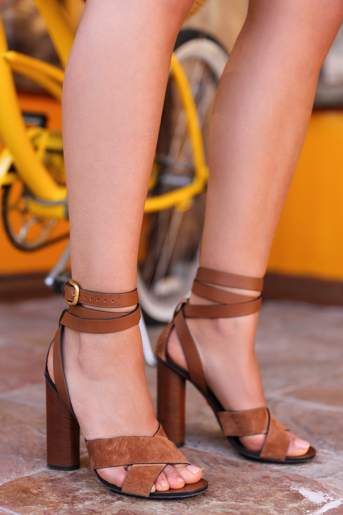 Suede Shoes For Summer: Annabelle Fleur is wearing a pair of dark camel suede Gucci heeled sandals