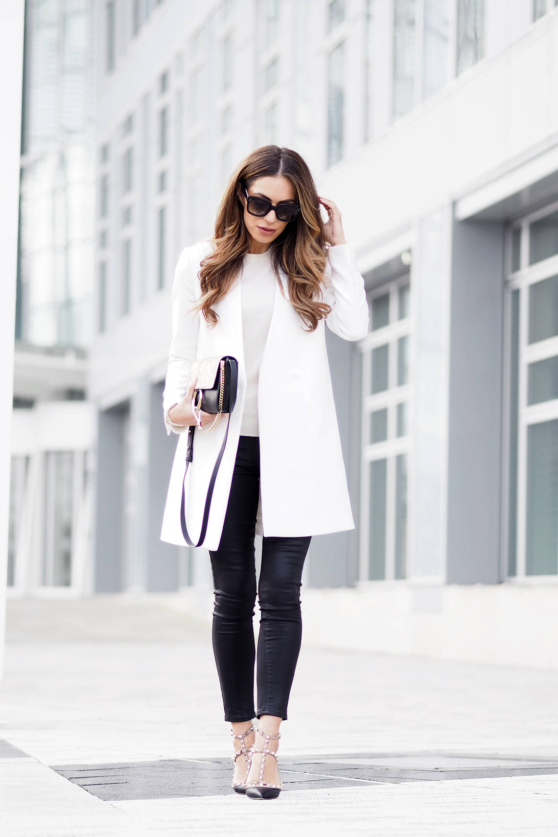 Lydia Lise Millen is making a fashion statement in black and white in this daring block monochrome outfit! Wear a pristine white coat such as this one from Jigsaw with black jeans to recreate this look. Jacket: Jigsaw, Cashmere Knit: John Lewis, Bag: Chloe, Jeans: Paige Denim, Shooes: Valentino.