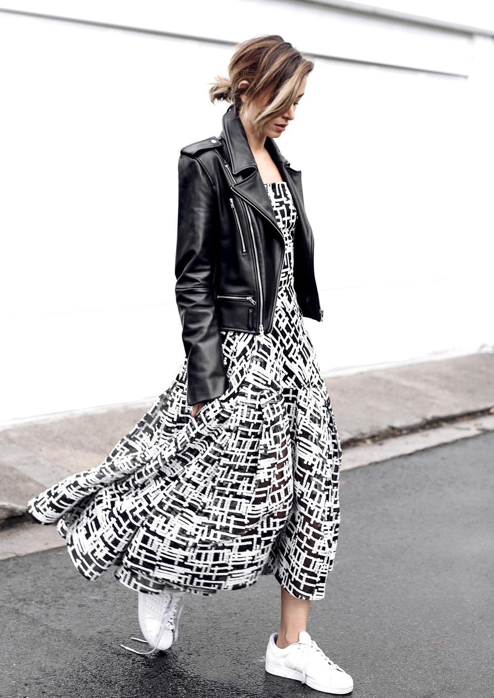 Black and white maxi dress, black leather jacket and pure white sneakers. Via Carmen Hamilton Jacket: Dion Lee, Dress: Toni Maticevski, Sneakers: Adidas
