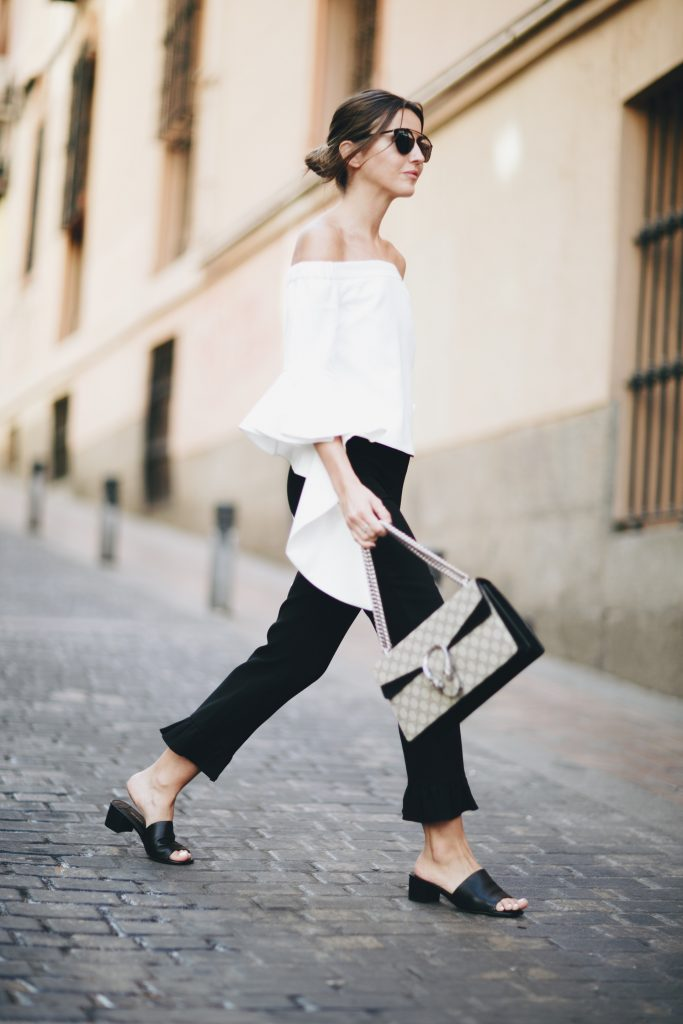 Alexandra Pereira has created the ultimate contrast in this bold black and white outfit, consisting of semi-flared cropped trousers and a bell sleeved white blouse. A look like this needs no dressing up, so pair it with sandals and a simplistic handbag! Top: Chicwish, Trousers: Zara, Sandals: Tony Bianco.