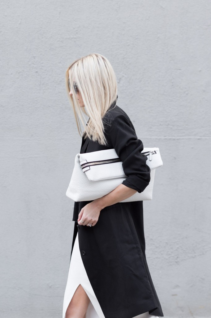 Figtny is wearing a black and white outfit, with the trench coat from Topshop and an asos maxi slit skirt