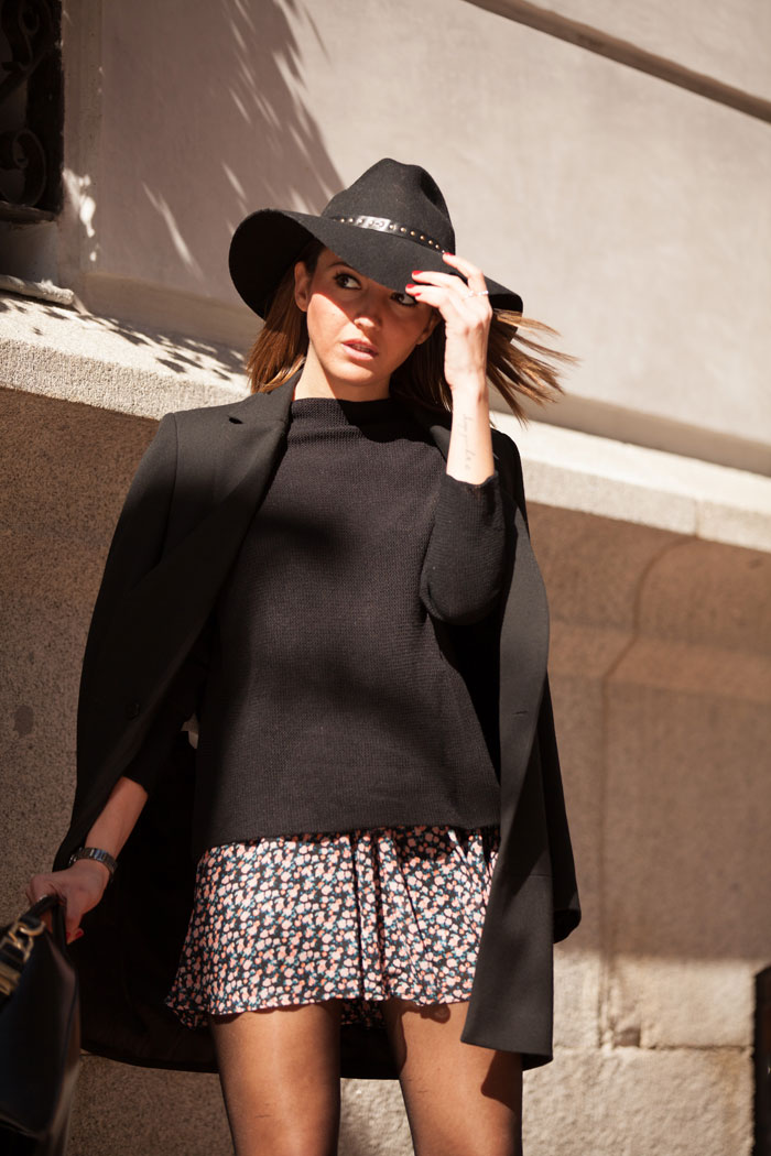 Alexandra Pereira is wearing a Buylevard mini skirt and a black overcoat