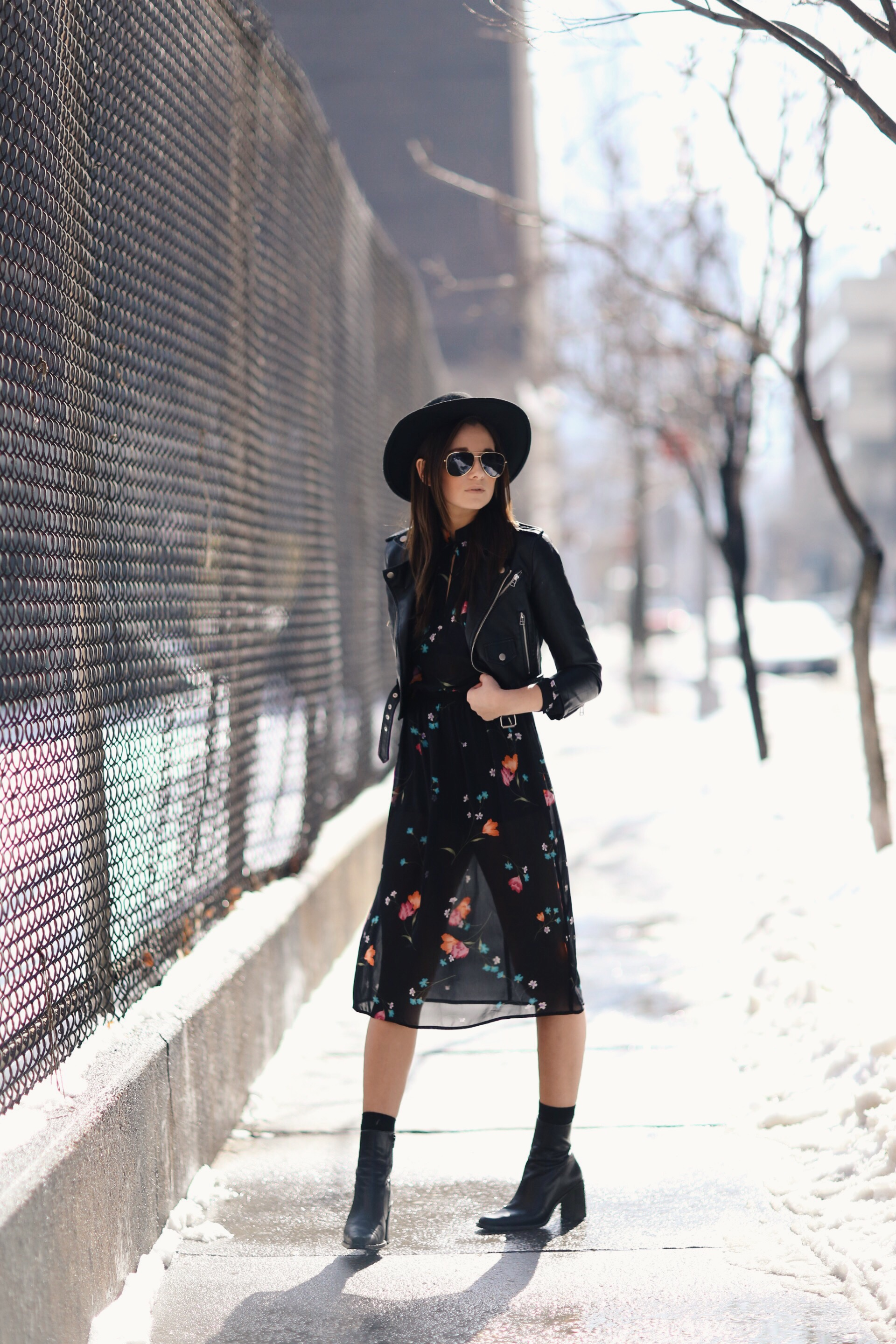 Street Style February 2015: Danielle Bernstein is wearing a cropped leather jacket from Nasty Gal, a vintage dress and a black Whistles hat