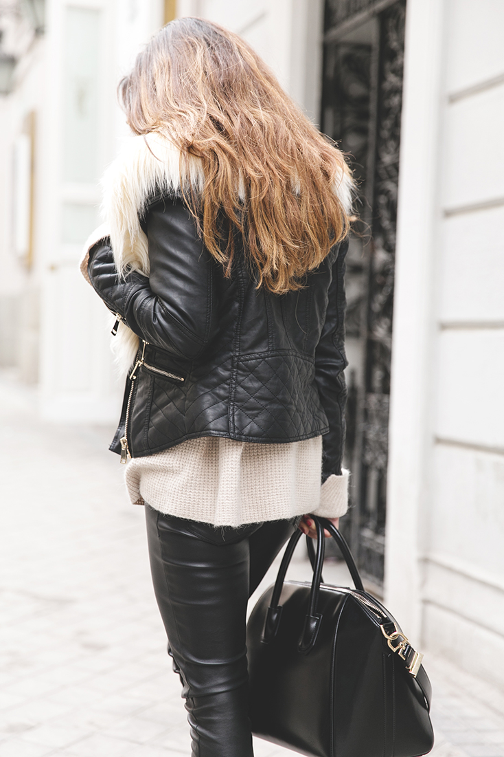 Paula Ordovás is wearing a biker jacket and knitted jumper from River Island, black trousers from FreePeople and a Givenchy Antigona handbag