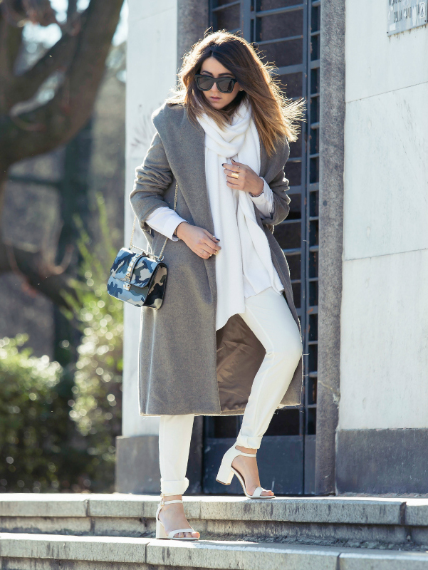 Nicoletta Reggio is wearing a grey coat and white scarf from Zara, trousers from Asos, bag from Valentino and the shoes are from Sarenza
