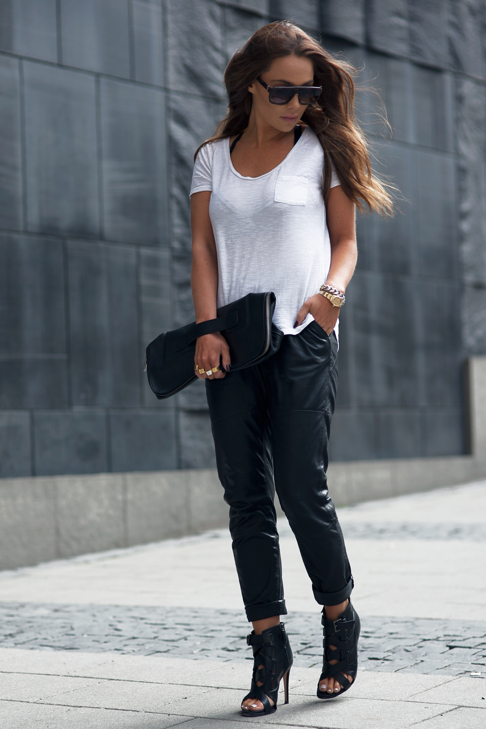 Black And White Fashion Trend: Johanna Olsson is wearing a white River Island tee pair with black leather Designers Remix trousers, DVF heels and a 3.1 Phillip Lim clutch bag