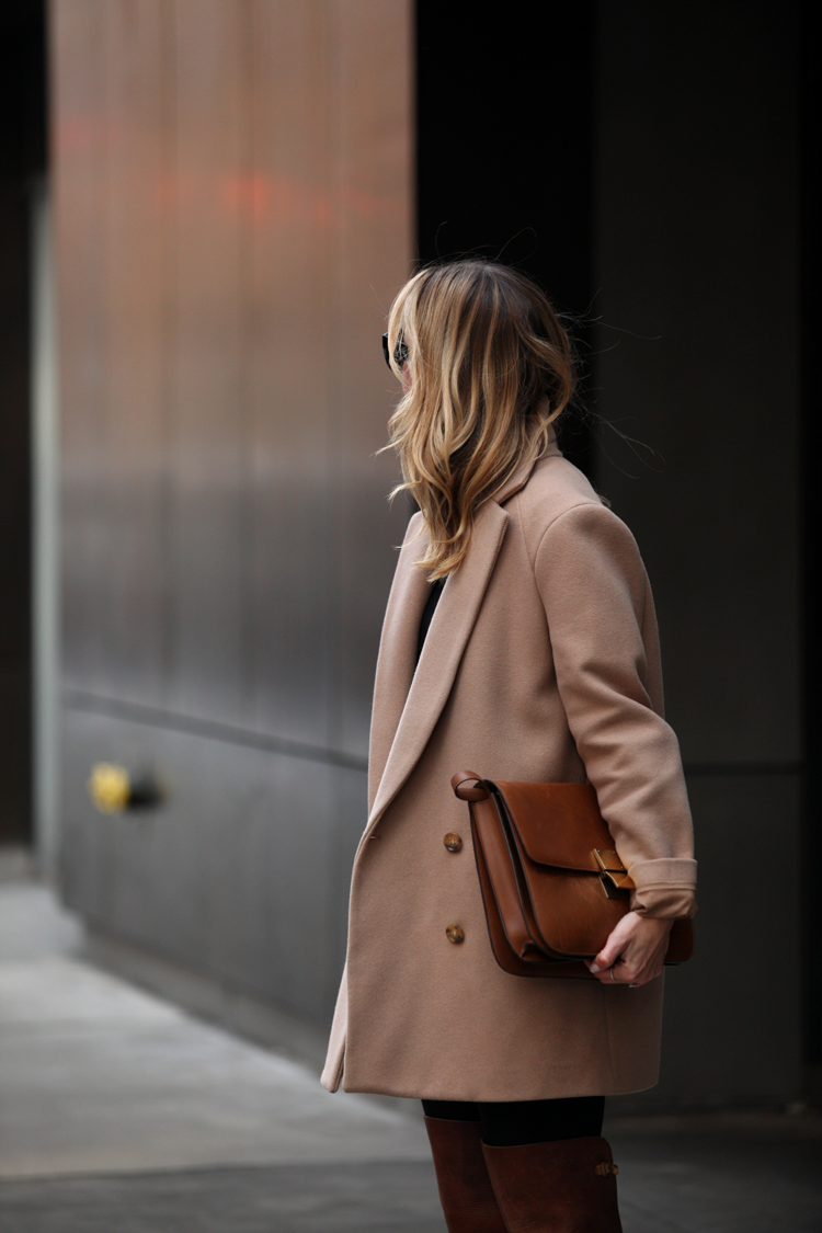 Helena Glazer is wearing a Theory coat with a leather Celine clutch