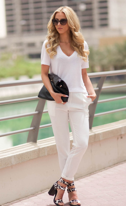 Black And White Casual Outfits: Sendi Skopljak is wearing white Gina Tricot t shirt with Persunmall trousers, a black clutch bag and animal print heels