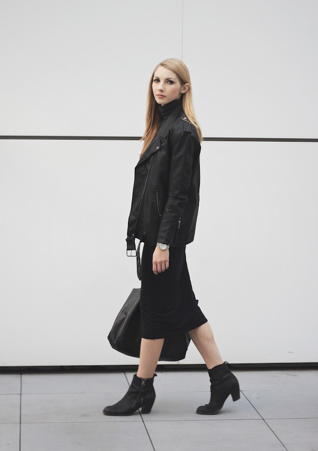 Via Just The Design: Pavlina Jagrova is wearing a black H&M biker jacket with a Win-Win black maxi dress and Acne ankle boots