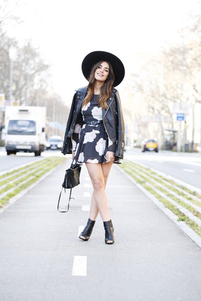 Aida Domenech is wearing a floral black Buylevard skater dress with a Mango leather jacket