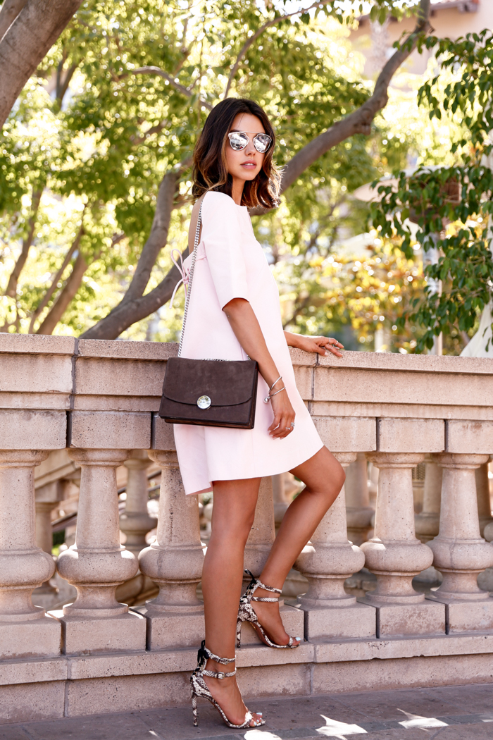 0ba1c27ca9 Pair a blush pink dress with python print sandals and a brown bag to set it