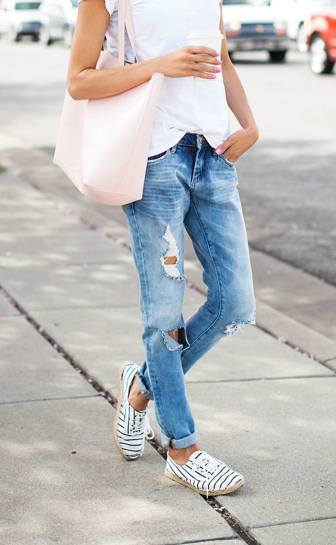 Christine Andrew is wearing ripped jeans from Blank NYC, espadrilles and blush pink tote are from Old Navy