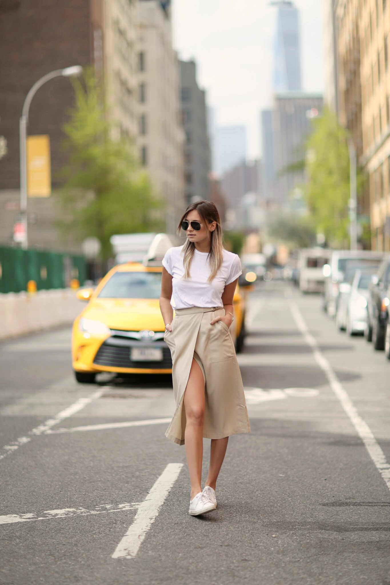 Skirts With A High Slit: Danielle Bernstein is wearing a midi beige Warehouse skirt