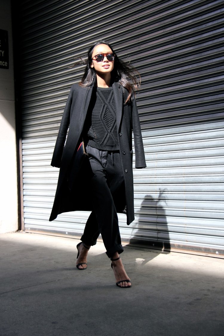 Linh Niller Huynh is wearing topshop trousers, a H&M sweater and Michael Antonio heels all in black