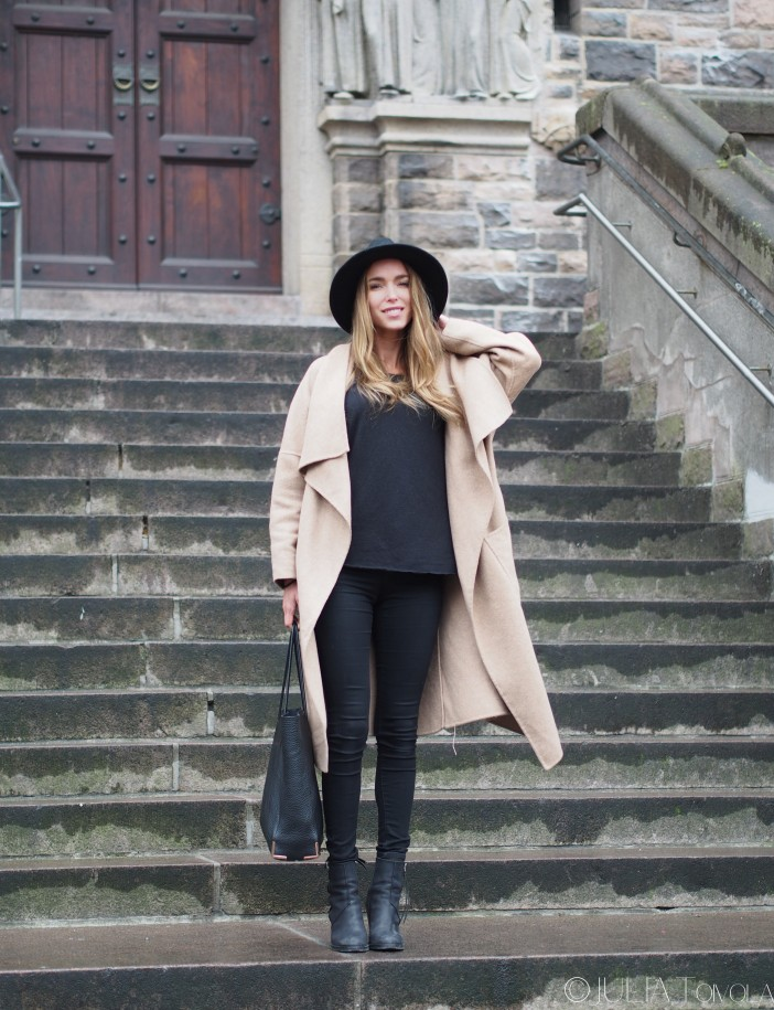 Street Style, March 2015: Julia Toivoloa is wearing a camel trench coat with a pair of black skinny jeans and ankle boots