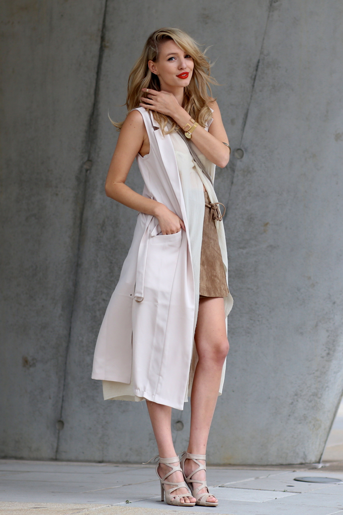 Take A Nude Colour Palette With The Sleeveless Coat And Suede Skirt To Create An